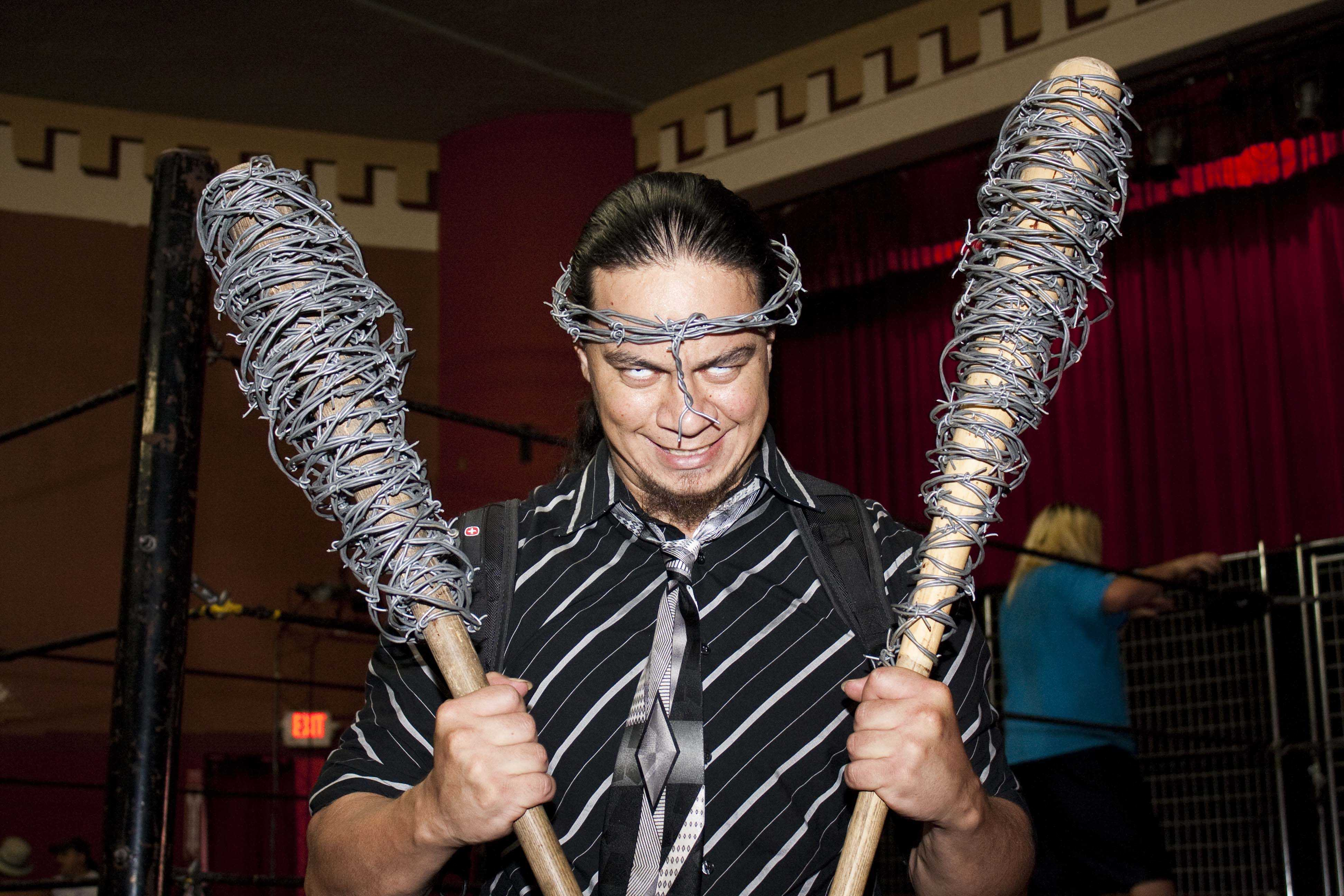 Ron Ruffio, a professional wrestler for the TWF, holds his bats wrapped with barbed wire and wears a barbed wire crown. (Photo by Bryce Fraser)