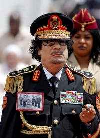 Libya's Gaddafi arrives in Italy for 'historic' visit