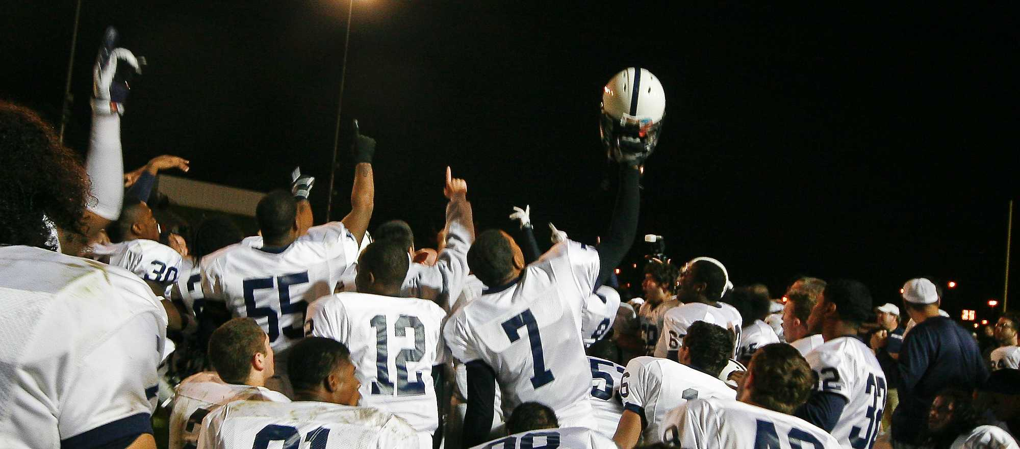 The American River College football team celebrates following a 41-18 win over Chabot College in the Capital City Bowl on Saturday, Nov. 22 at Beaver Stadium. The Beavers finished the season 11-0 -- the first undefeated season in school history. (Photo by Bryce Fraser)