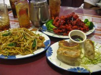 Chicken chow mein. orange chicken, and chicken pot stickers at the Pearl House Restaurant in Citrus Heights.