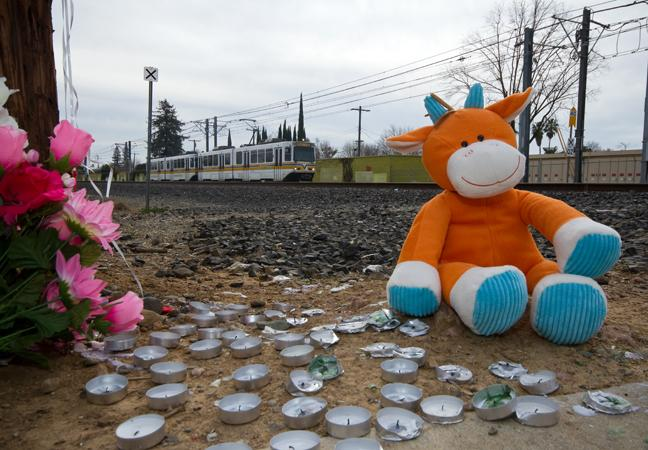 A vigil is set in place near the scene of the Jan. 28 light-rail accident that resulted in the death of two students. (Photo by Bryce Fraser)
