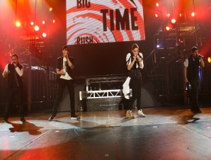 The four members of Big Time Rush performing in Sacramento on Feb. 20.