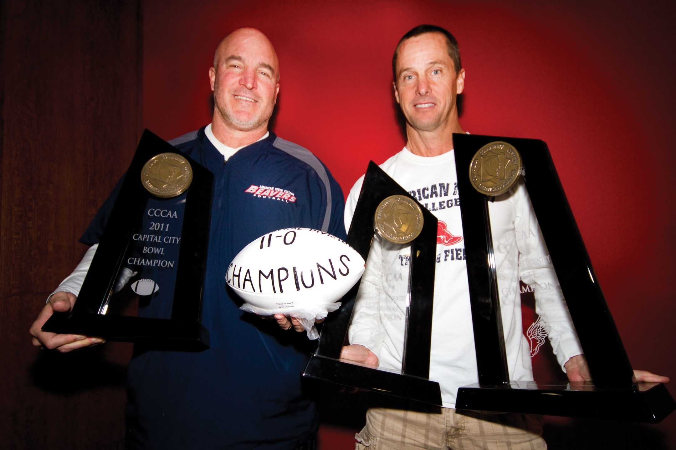 Head football coach Jerry Haflich and cross-country coach Rick Anderson. (Photo by Stephanie Lee)