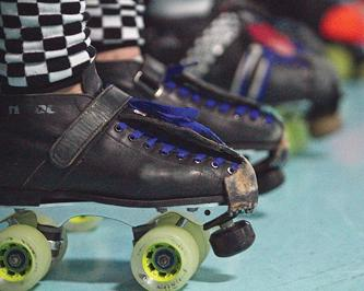 The skates of a roller derby girl at a practice on March 13. (Photo by Daniel Romandia)