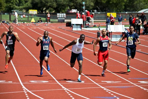 American River College sophomore sprinter Diondre Batson, center, crosses the finish line of the 100-meter race at the Stanford Invitational on April 6 in Palo Alto, Calif. Batson (10.27 seconds) set a school record in the race, and also set the school record in the 200-meter (20.53) on April 13 in Walnut, Calif. (Photo courtesy of Rick Anderson)