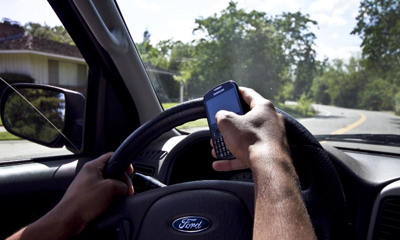 Campus police warn drivers of dangers of texting while behind the wheel, issue citations to offenders. (Photo Illustration by Daniel Romandia)