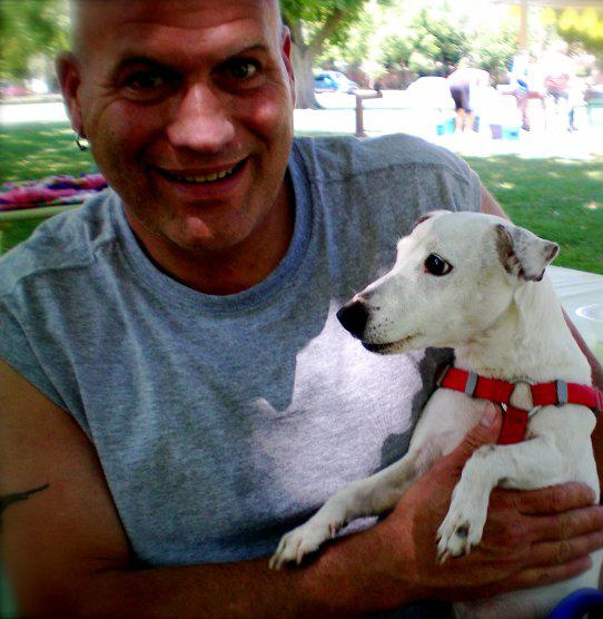 Clyde Wade, holding his dog Hootie, was diagnosed with HIV in 2004. Wade has since began helping others educate themselves on protection from the disease. (Photo courtesy of Clyde Wade)