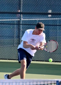 Simba Barratti stretches out to return a serve in his singles match versus Modesto Junior College player Xavier Lopez Feb. 12. Barratti went on to win the match (6-0, 6-0)