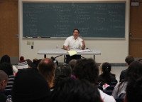 Professor Richard Gonzalez lectures his Business 300 class on Economics.
