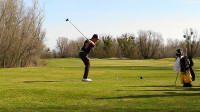 Freshman Colton Passey teeing off at Teal Bend Golf Course in Sacramento on March 9. Passey went on to finish the match shooting an 80.