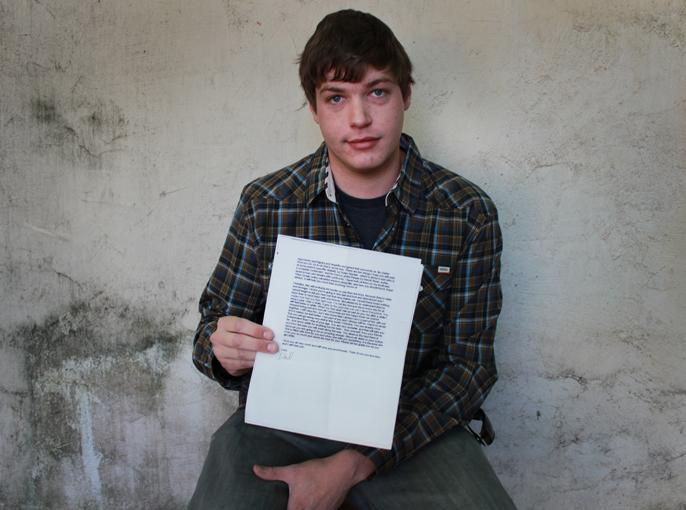 Eric Webb, 25, holds the suicide note written by  his father, Pulitzer Prize-winning journalist Gary Webb, on Thursday, April 18, 2013. (Photo by Emily K. Rabasto)