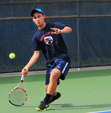 ARC's Tennis player Kevin Valentine in a match during the Big 8 North Conference Tournament hosted at ARC on April 5 and 6. Photo by Emily K. Rabasto