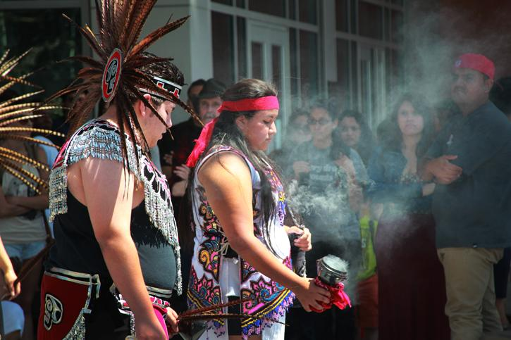 (Left to Right) High school student Flavio Venegas, 16, and American River College creative writing major Tona Miranda, 24, preform a traditional Native American ritual using incense and drums outside the student center on Thursday, May 2. (Photo by Emily K. Rabasto