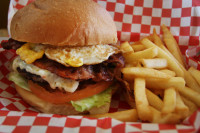 Burger Max constructs many different burgers including the Super Burger that is topped with your choice of cheese, two big slices of crisp bacon and a whole fried egg.