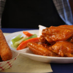 The 10 piece bone-in sweet and spicy buffalo wings are tender and can be ordered with a side of fried zucchini.