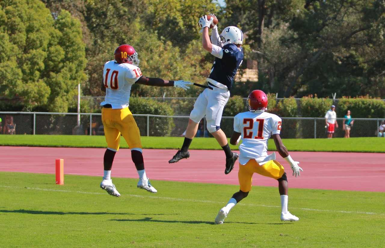 Wide Receiver Tyler Trosin sophomore, makes an impressive catch from quarterback Mike Hicks in the end zone against Sacramento City College on Saturday, Sept 14. Trosin scored three touchdowns for the Beavers. ARC won 34-7. Photo by Emily K. Rabasto