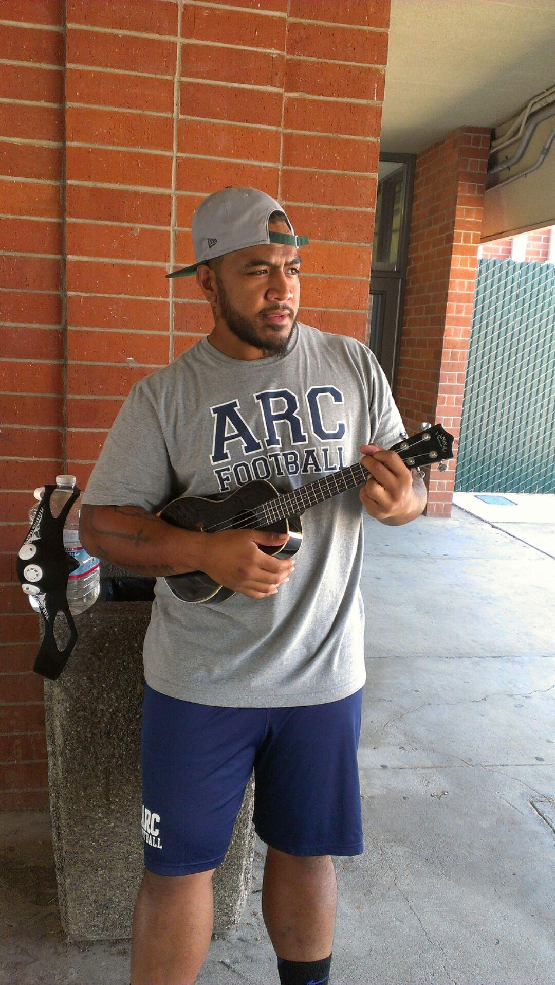Sophomore football player Sione Umufuke playing some sweet sounds and enjoying some downtime between classes and practice. The ARC football team won their season opener on Saturday in Monterey 40-2 and will host rival Sacramento City College at Beaver stadium this Saturday for their home opener at 1 p.m. Photo by Ed Gebing