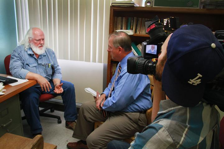 Professor Geoffrey Stockdale sits down with Tom DuHain of KCRA 3 to discuss the impromptu westling demonstration that occurred in his classroom the night of Oct. 14. (Photo by Alisha Kirby)
