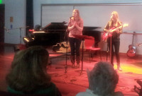 "Morgan Wright and Malia Artsitas perform ""Sandy Toes"" at the acoustic cafe Nov. 22."