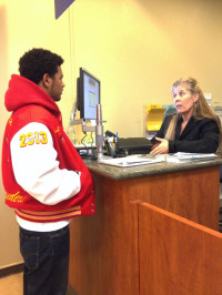 Counselor Jennifer Scalzi-Pesola helps ARC student with questions about spring registration.