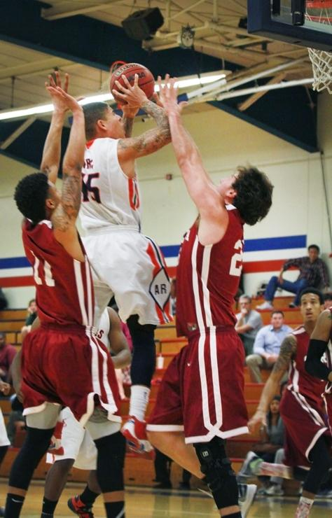 ARC guard Damion Trujillo shoots with two Sierra players defending