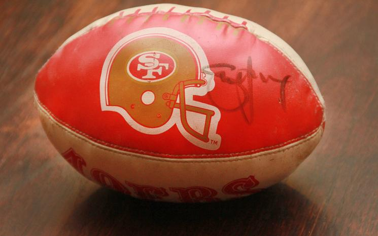A children's 49ers football autographed by Steve Young, the last Quarterback to win a Super Bowl as a 49er.