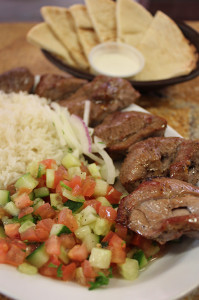 Royal Kebab located in Citrus Heights serves lamb marinated and spiced with cumin, paprika, bell pepper, Greek yogurt and lemon juice and cooked under an open flame oven and served with rice and a tomato and cucumber salad.