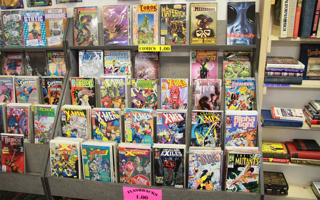 A comic book stand displaying various comics throughout the '90s can be located in the back right corner of the store.