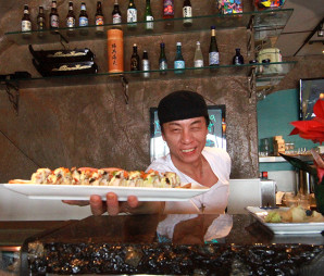 Chef Jimmy Kil serving up a plate of dragon roll