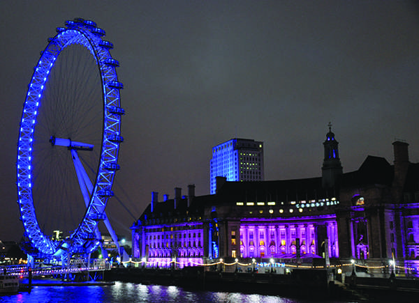 The London Eye, where Barnes and Ice shared their first kiss, is lit up at night.