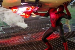 Spider-Man catches a police car tossed by Electro's telekinetic abilities