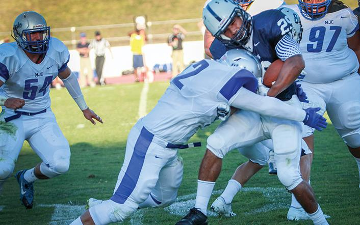 Freshman running back Casey Lambert is tackled during the first home game at American River College against Modesto Junior College on Sept. 6. (Photo by Emily K. Rabasto)