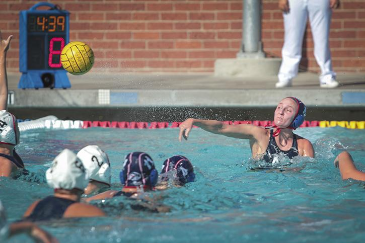 Emily Perry, an American River College sophomore, shoots and scores in a water polo match against Santa Rosa Junior College on Sept. 24. The ARC women's team won the match in double digits 15-4. (Photo by Emily K. Rabasto)