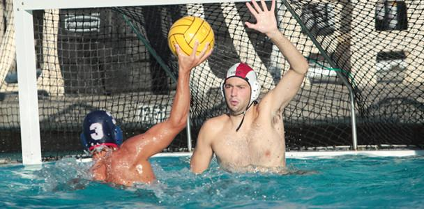 Freshman Ryan Eyman attempts a shot in a water polo match against Santa Rosa Junior College on Sept. 24. The American River College men's team won the match 15-11.