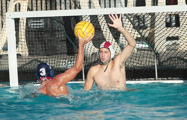 Freshman Ryan Eyman attempts a shot in a water polo match against Santa Rosa Junior College on Sept. 24. The American River College men's team won the match 15-11. (Photo by Emily K. Rabasto)
