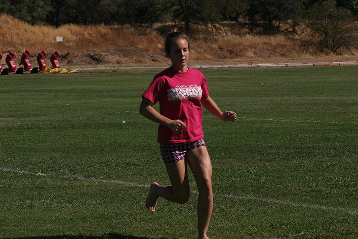 Jenica Dodge, the fastest women on the American River College cross-country team, warms up. (Photo by Jessica Vang)