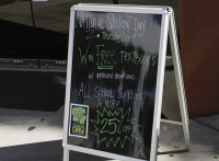 A sign outside of the American River College Beaver Bookstore advertises National Student Day and the events going on Oct. 9.