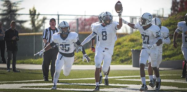 The American River defense congratulates No. 8 Malcom Scott on his touchdown during the game against Sierra College on Nov. 1. Scott, like many other players, moved from out of state to play football for ARC.
