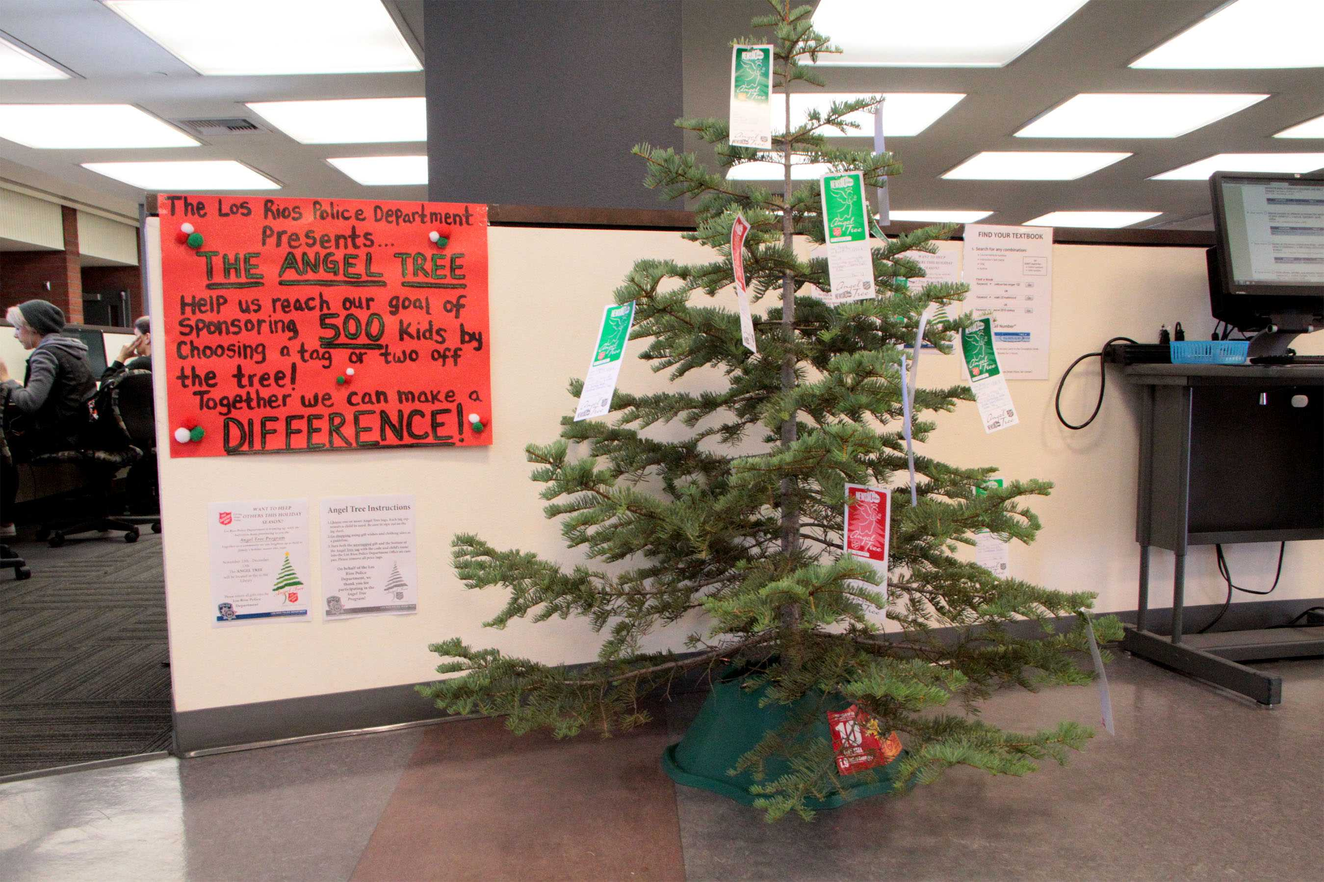 """""""We have placed a tree up with these tags on so that our students, and staff can choose a tag and help a child this holiday season,"""" said Los Rios Police Officer Ben Ernest."""