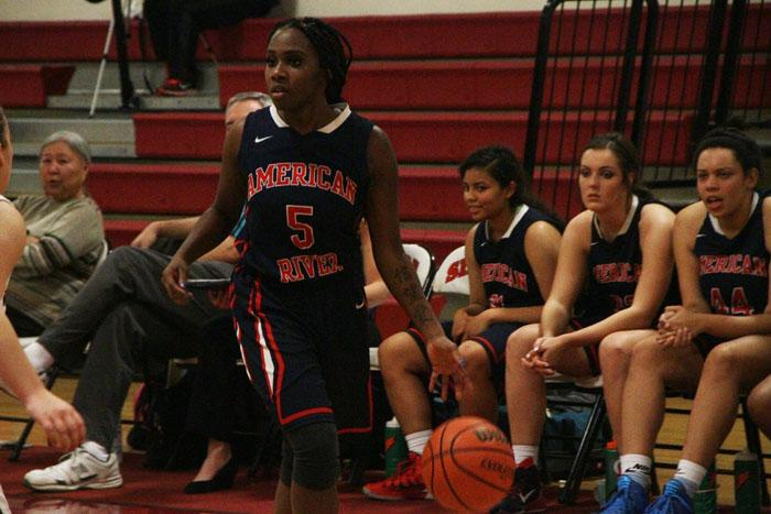 ARC guard Demontra Harrison dribbles the ball up the court during their loss at Sierra.