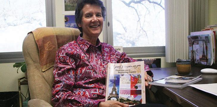 "French Professor Deirdre Wolonick, mother of world famous free solo rock climber Alex Honnold, with her most recent publication 'Je Parle Francais… un peu"" a required textbook for her French 400 and 401 classes."