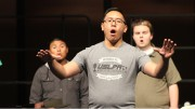 """Tim Mascarinas, a Sacramento State student practicing at ARC, conducts the chamber choir at the rehearsal for their performance """"It Gets Better""""."""