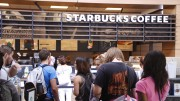 Students brace a long line at the Starbucks in the Student Center on Wednesday. In spite of the opening of a new Peet's in the portable village, many students remain brand-loyal to the long-established Starbucks. (Photo by Kameron Schmid)