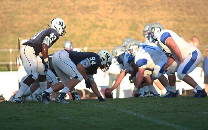 Linebacker Lawrence Hall, left, and defensive lineman Caleb Melton, right, line up against Modesto Junior College players on Sept. 6, 2014. ARC held MJC to 347 yards in the last meeting, MJC's second lowest total of the season. (File photo)