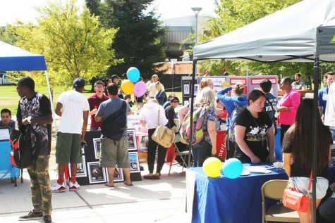 Clubs are gathered around the student center encouraging students to join. Game-themed Club Day was hosted at ARC on Sept. 24, 2015. (Photo By Ashley Nanfria)