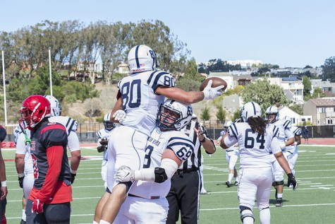 American River College's Steven Ponzo lifts Marc Ellis in celebration after scoring a touchdown against City College of San Francisco in San Francisco on Sept. 26. ARC won the game on a last second field goal 20-17.