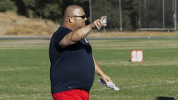 American River College Defensive Coordinator Lou Baiz points out a play downfield during practice on Wednesday, Sept. 2, 2015. Baiz comes from a family of coaches, including his father, who was a head coach for 35 years. (Photo by Joe Padilla)