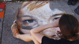 """Folsom Lake College student Julia Flippo works on her close up chalk profile of a young girl at Chalk It Up's 25th annual art festival Labor Day Weekend in Fremont park, downtown Sacramento. Flippo placed second in """"The Peoples Choice,"""" an award that all artists who rent out a sidewalk space are contenders for."""