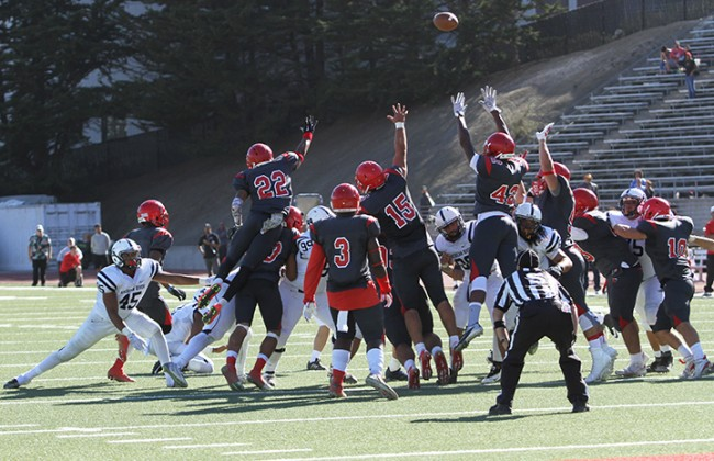 City College of San Francisco's special teams players attempt to block American River College's game-winning 25 yard field goal during ARC's 20-17 win over CCSF on Sept. 26, 2015. The game-ending field goal win was a reversal of the 2014 NorCal Championship game, which ARC lost 17-14 when CCSF scored a field goal during the last minute of the game. (Photo by Barbara Harvey)