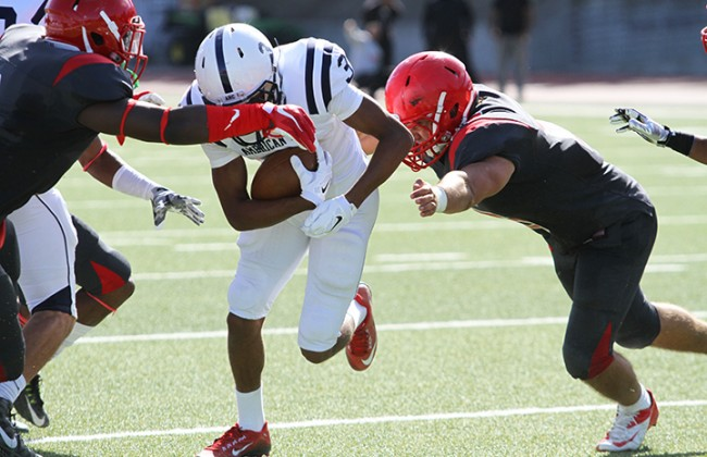 City College of San Francisco defensive back Vince Camp and linebacker Khalil Hodge attempt to bring down American River College wide receiver Damen Wheeler during ARC's 20-17 win over City College of San Francisco on Sept. 26, 2015. ARC's offense had 389 total yards. (Photo by Barbara Harvey)